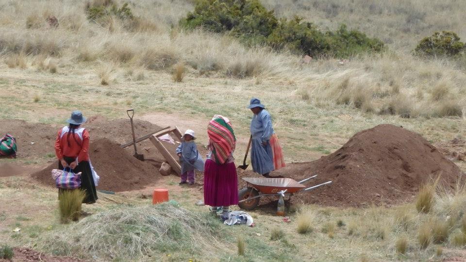 women digging for artifacts